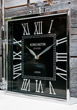 Kensington Station Clock. Against rustic wooden boards Royalty Free Stock Photos