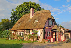 Kent country thatch cottage. Photo of a pretty 18th century chocolate box kent country thatch cottage royalty free stock images