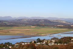 Kent estuary and Lake District from Arnside Knott. View from Arnside Knott in Cumbria looking across the River Kent estuary and Arnside viaduct with two trains Stock Photo