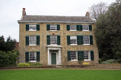 Kent georgian period manor house. Photo of kent georgian period manor house with green shutters in a quiet peaceful rural location Royalty Free Stock Images