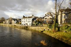 Kent Riverside Buildings, Kendal. Autumn view of buildings along river Kent in Kendal, Cumbria, UK Stock Photos