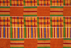 Kente cloth ghana. Close up of traditional kente cloth, cotton fabric made of interwoven cloth, usually worn for ceremonies, festivals, and other sacred Royalty Free Stock Images