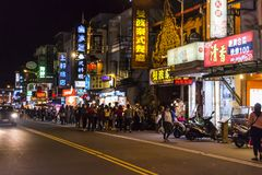 Kenting Street becomes a lively market at night, when it is filled with food stalls & street vendors stock photo