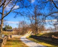 Kentucky country scene. Gravel road on a farm in Central Kentucky in fall Stock Photos