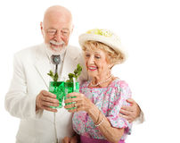 Kentucky Derby Day Juleps. Southern senior couple enjoying traditional mint julep coctails to celebrate the Kentucky Derby. Isolated on white stock photo