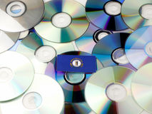 Kentucky flag on top of CD and DVD pile  on white Stock Images