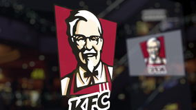 Kentucky Fried Chicken KFC logo on the glass against blurred business center. Editorial 3D rendering Royalty Free Stock Photography