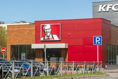 Kentucky Fried Chicken KFC restaurant. St. Petersburg, Russia - May 04, 2019: Kentucky Fried Chicken KFC restaurant, fast food with parking stock images