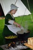 KENTWELL HALL SUFFOLK UK : May 05, 2014: Medieval woman cooking Royalty Free Stock Images