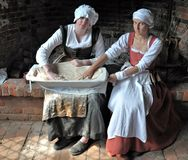 Kentwell Hall Tudor Recreation 1538 (2010). Boulting Flour in the Bakehouse Royalty Free Stock Images