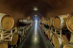 Kenwood, California - April 28, 2019: Cask storage in underground wine cellar in Deerfield Ranch Winery in Sonoma Valley. Aging wine barrels at Deerfield in stock photography