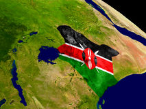 Kenya with flag on Earth Stock Photo