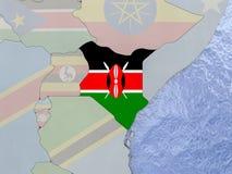 Kenya with flag on globe Royalty Free Stock Image