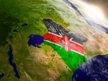 Kenya with flag in rising sun Stock Photography