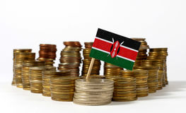 Kenya flag with stack of money coins Stock Photo