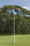 Kenya, flag waves in green grass yard of Karen Blixen Museum and Blixen home in Nairobi, Kenya, Africa Royalty Free Stock Photo
