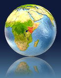 Kenya on globe with reflection. Illustration with detailed planet surface. Elements of this image furnished by NASA Royalty Free Stock Image