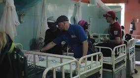 KENYA, KISUMU - MAY 20, 2017: Caucasian men in African hospital talking with people. Volunteers helping to local people.