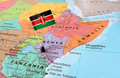 Kenya map and flag pin. Kenya paper flag pin on a map, exotic travel concept royalty free stock photo