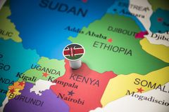 Kenya marked with a flag on the map.  royalty free stock photography