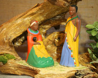 Kenya nativity scene with wooden statues with colored African ro Royalty Free Stock Photography
