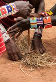 Kenya, Tsavo East - masai people setting the fire by their hands. In national park royalty free stock photos