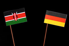 Kenyan flag with German flag isolated on black Royalty Free Stock Images