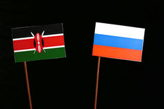 Kenyan flag with Russian flag isolated on black Royalty Free Stock Photography