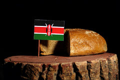 Kenyan flag on a stump with bread Royalty Free Stock Photo