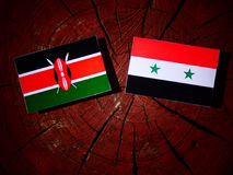 Kenyan flag with Syrian flag on a tree stump  Stock Image