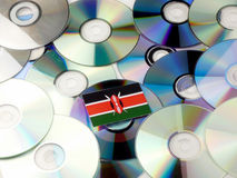 Kenyan flag on top of CD and DVD pile isolated on white Stock Photography