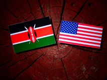 Kenyan flag with USA flag on a tree stump  Royalty Free Stock Images