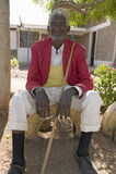 A Kenyan man sits with red jacket on at the Pepo La Tumaini Jangwani, HIV/AIDS Community Rehabilitation Program, Orphanage & Clini Royalty Free Stock Photography