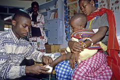 Kenyan Masaai child gets-styled shoes. Kenya, district Kiambu, in the Kijabe mission station is located the AIC [Africa Inland Church] Kijabe hospital, the Royalty Free Stock Photo