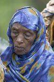 A Kenyan woman with a blue scarf stands in line at the Pepo La Tumaini Jangwani, HIV/AIDS Community Rehabilitation Program, Orphan Stock Images