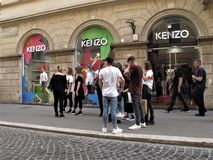 Kenzo clothing store. A group of young people in front of Kenzo clothing store royalty free stock images