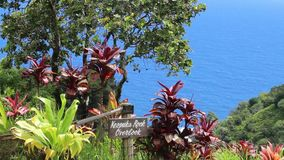 Keopuka Rock Overlook view, Garden Of Eden, Road to Hana, Maui, Hawaii, USA. Keopuka Rock Overlook view on the ocean from the lush vegetation in the Garden Of stock footage