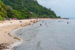 Kep Beach. KEP - DECEMBER 11: The Kep Beach on December 11, 2016 in Kep, Cambodia. Tourists unidentified spend time on the beach which is a bit littered by royalty free stock photo