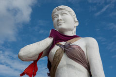 Kep siren statue, the symbol of Kep beach, partially dressed. Stock Image