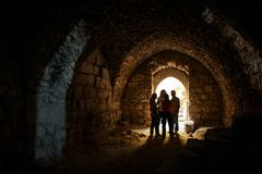KERAK, JORDAN - Nov 2009: A small group of tourists in a chamber at Kerak Castle in Jordan royalty free stock photos