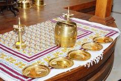 Kerala hindu wedding function arrangement. A kerala malayalee wedding function stage decoration with nirapara brass vessel and brass plates Stock Photo