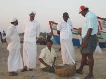 Kerala India beach men sand. Boats men Moslems India people exotic sandy beach group Stock Photo