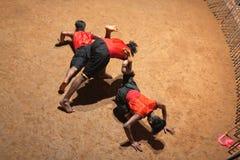Kalaripayattu Martial Art in Kerala, India. KERALA, INDIA - NOVEMBER 10, 2016: Indian fighters performing Kalaripayattu marital art. Kalaripayattu is an ancient Royalty Free Stock Photography