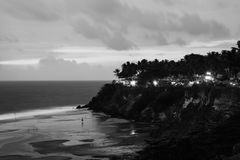 Varkala beach at night, various cafes and restaurants at the cliff in Kerala, India. Black and white. Kerala, India. Varkala beach at night, various cafes and royalty free stock photography