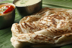 Kerala Paratha - a layered flatbread from Kerala. Kerala Paratha - a layered flatbread from South Indian state of Kerala served with coconut chutney and sambar Royalty Free Stock Photos