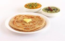 Kerala Paratha z masło polewą i Bocznymi naczyniami Obrazy Royalty Free
