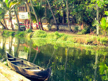 Kerala stream. Black water stream in kerala with a beautiful greenery and a fishery boat Royalty Free Stock Photos