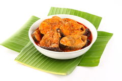 Kerala style fish curry with red chilly and herbs. Bowl of Kerala style fish curry with red chilly and herbs.served with banana leaf stock images