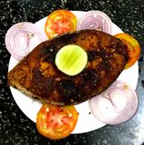 Kerala style Fried seer fish. Decorated with sliced onions and tomatoes Royalty Free Stock Photography