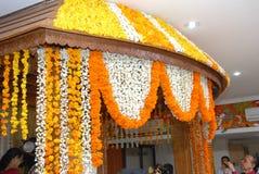 A kerala wedding flower decoration. 10 SEP 2010 GURUVAYUR KERALA INDIA - a kerala hindu malayalee wedding stage decoration with flowers garlands Stock Photography